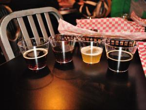 Beer pairings with dessert at BrewMasters during Dishcrawl. From left to right: Lonerider Sweet Josie, Mother Earth Dark Cloud Dunkel, Delirium Tremens and Stoudts Fat Dog Imperial Oatmeal Stout.