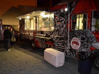 The Porchetta food truck outside of CAM featuring art designed by Matt Curran