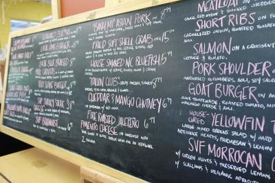 Daily specials are noted on the chalk board.
