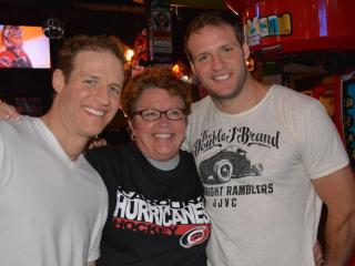 """The Battaglia brothers pose with fan at Lucky B's in Raleigh during the final episode of """"The Amazing Race"""" on Sunday, May 5, 2013. Anthony and Bates Battaglia won the race and its $1 million prize."""