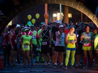 Runners of The Great Glow Run 5K get ready for the start of the event on May 11, 2013. Photo by John West