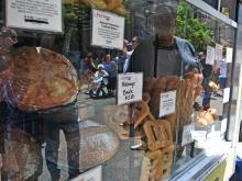 Fresh bread and pastries on display at the La Farm Bakery truck during the Downtown Raleigh Food Truck Rodeo.