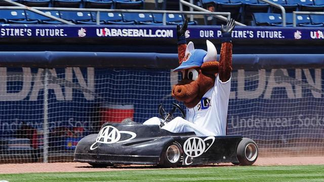 Wool E. Bull races his go-kart around the field prior to the Lehigh Valley IronPigs-Durham Bulls baseball game Monday, May 13, 2013, at the Durham Bulls Athletics Park. The game was the fifth of the season with a daytime first pitch and ended with a Bulls 8-2 victory. The last scheduled day game will be played on June 3. (Photo by Jeffrey A. Camarati)