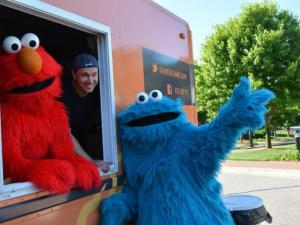 Elmo, Cookie Monster and Paul Inserra owner of American Meltdown.