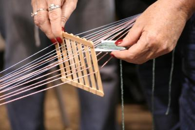 A weaving loom created from popsicle sticks. Photo by Tony Rice.