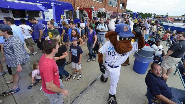 Wool E. Bull makes his way through the crowd during the DBAP Food Truck Fest at the Durham Bulls Athletic Park Wednesday, July 10, 2013 in Durham, NC.