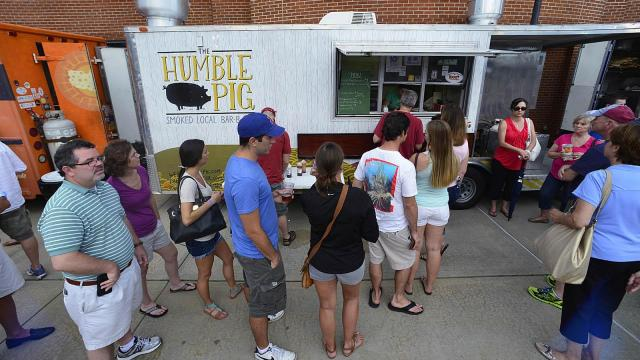 Fans line up to place an order at Humble Pig during the DBAP Food Truck Fest at the Durham Bulls Athletic Park Wednesday, July 10, 2013 in Durham, NC.
