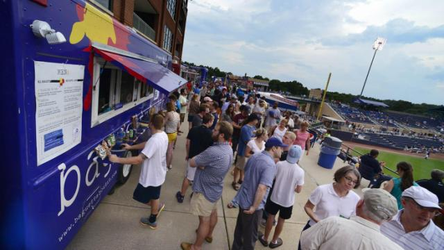 Long lines kept many fans waiting to place their orders during the DBAP Food Truck Fest at the Durham Bulls Athletic Park Wednesday, July 10, 2013 in Durham, NC.