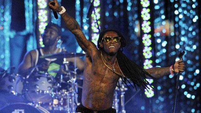 "Lil Wayne performs at the Caesars Entertainment ""Escape To Total Rewards"" concert in Los Angeles, Thursday, March 1, 2012. Simultaneous concert events were held in New York, Chicago, New Orleans and Los Angeles. (AP Photo/Chris Pizzello)"