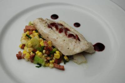 Course 1: Sweet Corn & Johnston County Prosciutto Style Ham Chow Chow, Butter Poached NC Flounder, Elderberry Glaze (Image from Competition Dining)