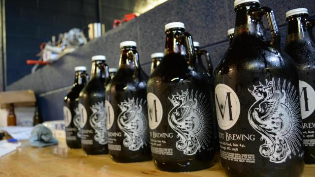 Mystery Brewing prepares growlers at their brew house in Hillsborough.