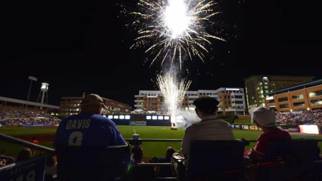 A fireworks show dazzles the crowd of 11,536, the third largest in the park's history, following Durham's win over Norfolk Saturday, August 24, 2013 at the Durham Bulls Athletic Park in Durham, NC.