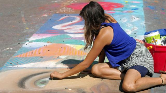 An artist finishes her masterpiece on Sunday afternoon.