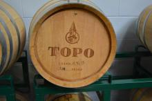 Whiskey is aged in barrels at TOPO Distillery.