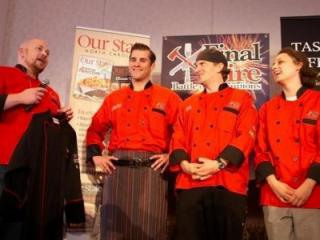 Team Red Stag Grill is presented with their black chef jackets as winners of Final Fire 2013. (Image from Competition Dining)