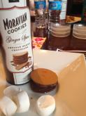 Salem Baking Company's ginger spice Moravian cookie dipped in chocolate and topped with a toasted marshmallow makes a great s'moravian!