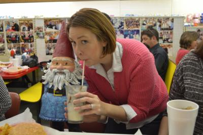 The Travelocity Roaming Gnome shares a milkshake with WRAL Out and About Editor Kathy Hanrahan at Sutton's drug store in Chapel Hill on March 5, 2014.