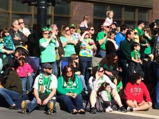 Crowds line the street for the annual Raleigh St. Patrick's Day parade.