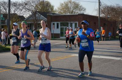 Runners race from Chavis Park to Historic Oakwood during the Rock 'n' Roll Raleigh Marathon and Half Marathon.