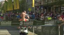 Women's winner crosses finish line at Rock 'n' Roll Marathon