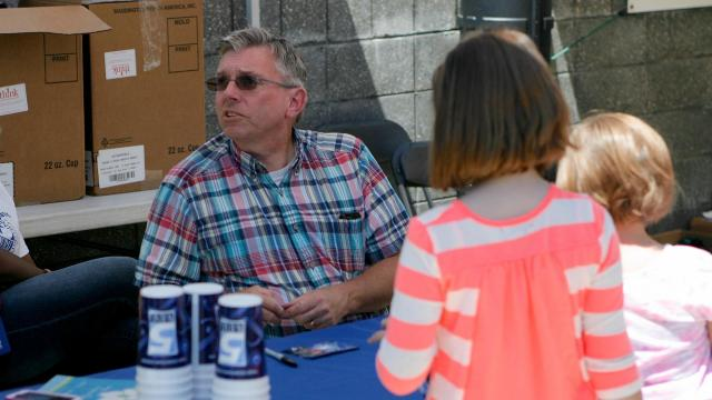 WRAL Chief Meteorologist Greg Fishel greets viewers during the annual Dogwood Festival held in Fayetteville Saturday afternoon.  Wes Hight / WRAL Contributor