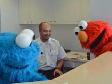 Elmo, Cookie Monster work WRAL reception desk