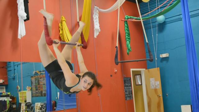Trapeze instructor Carlie Huberman does the Bird's Nest at Cirque de Vol.