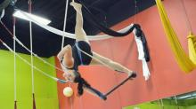 Cirque de Vol instructor Carlie Huberman on the trapeze.