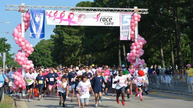 People ran and walked to help raise money for breast cancer research during the 2014 Komen Triangle Race for the Cure.
