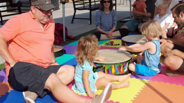Families enjoy a musical play space