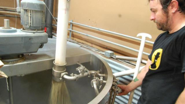 Lonerider Brewing Company's head brewer Galen Smith starts the mash.