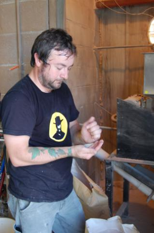 Lonerider Brewing Company's head brewer Galen Smith works with some grains.