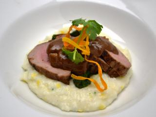 Course 2: Roasted Heritage Farms Cheshire Pork Tenderloin, Texas Pete® Cha! Mole, Stone Ground Old Mill of Guilford Grits, Wilted Swiss Chard (Mandolin) (Image from Competition Dining)