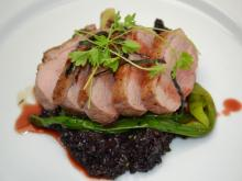 Course 3: Pan-Seared Maple Leaf Farms Duck Breast, Texas Pete® Cha!Wine Sweet & Sour, Mona Lisa Dark Chocolate Forbidden Rice, Grilled Scallions (Mandolin) (Image from Competition Dining)