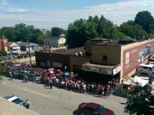 Crowds lined up outside Lincoln Theatre in Raleigh to get into two $1 admissoin J. Cole shows on July 19, 2014. (Photo by Stephanie Beck)