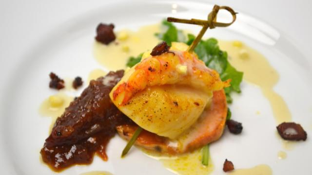 Course 2: Butter Poached American Prawn Cooperative & Scallop, Nature's Pearl Muscadine & Tomato Chutney, Roasted Sweet Potato, Muscadine Candied Bacon & Fennel with a Sweet Corn Jus (Jimmy V's) Weighted Score: 30.144. (Image from Competition Dining)