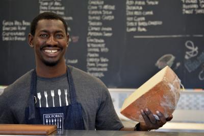 Store manager Dawda Janneh at Six Forks Cheese in Lafayette Village