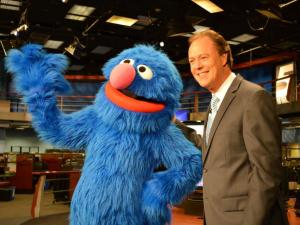 "Grover poses with WRAL's Bill Leslie during a visit to WRAL to promote their new show, ""Sesame Street Live: Make a Friend."""