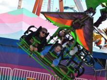 Folks enjoy rides at the 2014 NC State Fair.