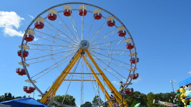 Folks enjoy rides at the N.C. State Fair on Oct. 22, 2014.