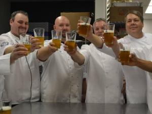 Chefs from Rex Healthcare and Top of the Hill share a toast after their Competition Dining battle on Jan. 20, 2015.