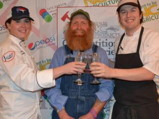 Chelsi Hogue of Ed's Southern Food and Spirits and chef Ben Adams of Piedmont Restaurant toast with Randy Lewis owner and operator of Ran-Lew Dairy.