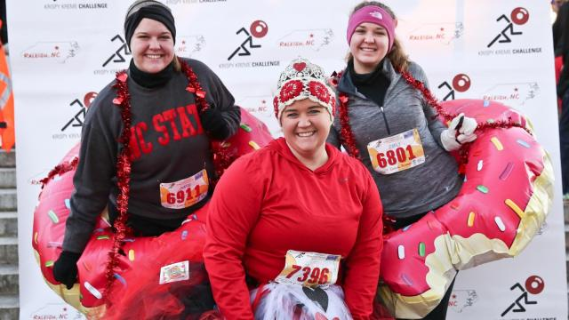 Emily Reynor, Emily Phillips and Katie Stephenson before the Krispy Kreme run. Thousands of runners came out on early Saturday morning to participate in the 11th Annual Krispy Kreme Challenge on February 14th, 2015 in Raleigh, North Carolina. Participants ran from North Carolina State University's Bell Tower to a Krispy Kreme to consume numerous donuts, and then run back to the bell tower. (Photo By: Chris Baird / WRAL Contributor)