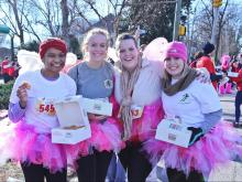 Thousands braved cold temperatures and a dozen doughnuts Saturday, Feb. 14, 2015, for the 11th annual Krispy Kreme Challenge.
