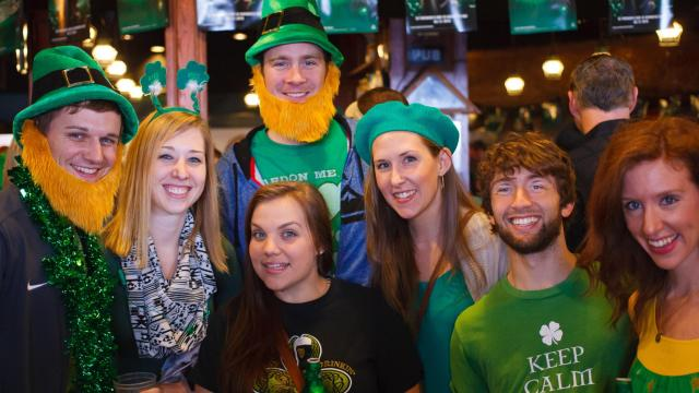 Patrons pose for a photo inside Tir na Nog. Photos by: Carlton Bassett