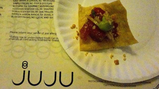 Juju Asian Tapas & Bar plated Hawaiian Ahi Poke with macadamia-soy jus, avocado, nori and sweet onion.