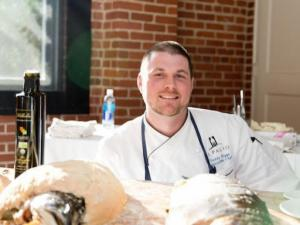 Chef Teddy Diggs of Il Palio Ristorante served salt-roasted wild king salmon that he overnighted from Alaska at Thursday night's Grand Taste Experience at the Durham Armory.