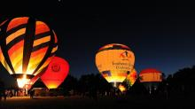 IMAGES: Hot air balloons light up the night in Zebulon