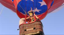 IMAGES: Balloons glow, tether at Spring Forest Road