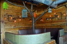 Raleigh Beer Garden's second floor seating includes this booth with a tree in the middle.
